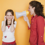 Mother yelling at daughter (10-12 years) through megaphone